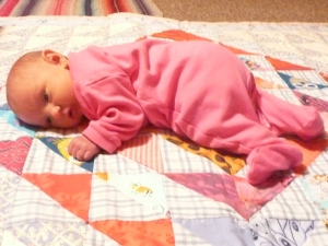 Baby obscuring quilt