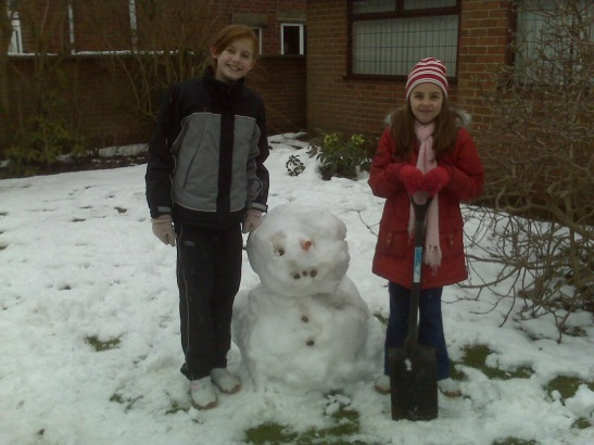 Friends with small fat snowbloke